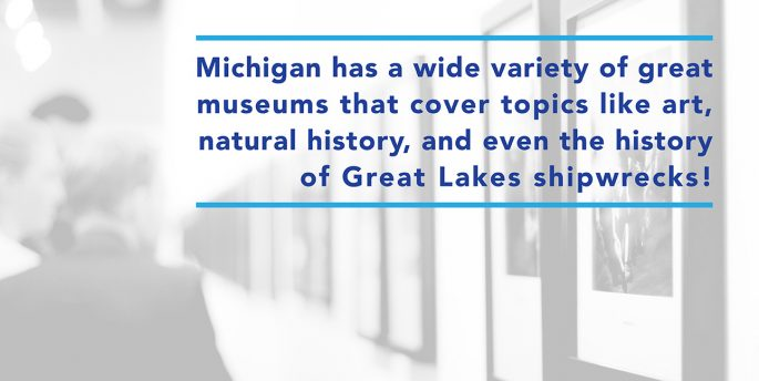 "The hallway of a museum features blue text that reads, ""Michigan has a wide variety of great museums that cover topics like art, natural history, and even the history of Great Lakes shipwrecks!"""