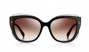 Tiffany & Co.'s cat eye sunglasses feature pink lenses.